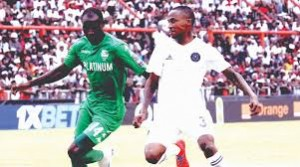 Tussle for ball possession: FC Platinum against Orlando Pirates at Barbourfields Stadium, Bulawayo,  Zimbabwe