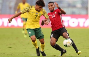 Hamdou Elhouni of Libya challenged by Keagan Dolly of South Africa during the 2019 African Cup Of Nations Qualifier match between South Africa and Libya at the Moses Mabhida Stadium